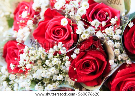 red rose bouquet with money wrapping rose