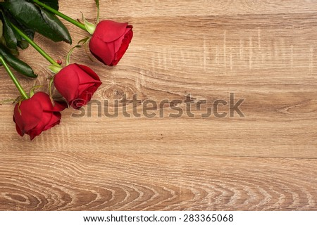 Red rose flower on wood background - stock photo