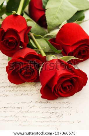 red rose flowers and old love letters. romantic vintage style background. selective focus
