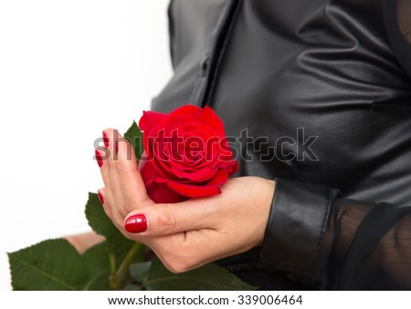red rose in her hand