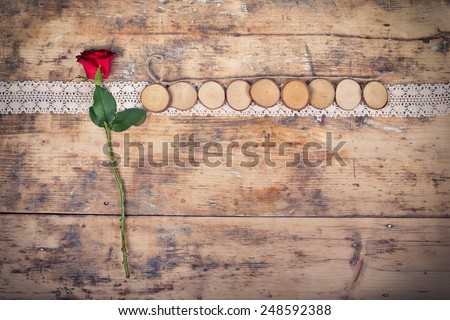 Red rose on wooden Background - Valentines concept - stock photo
