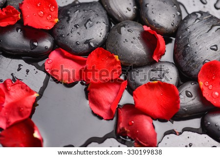 Red rose petals and therapy stones  - stock photo