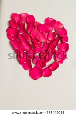 Red rose petals heart. Isolated on white background