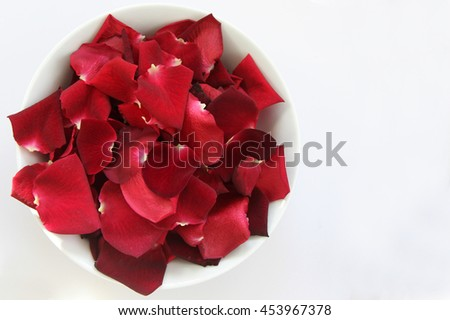 Red Rose Petals in a bowl with space for text