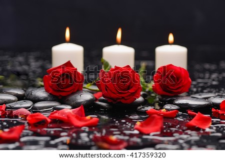 Red rose,petals with three candle and therapy stones  - stock photo