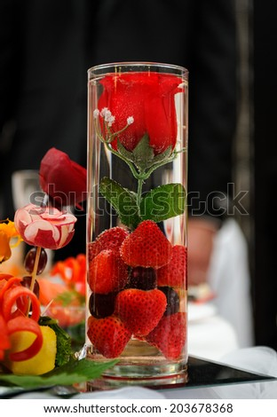 Red rose wedding table decoration - stock photo