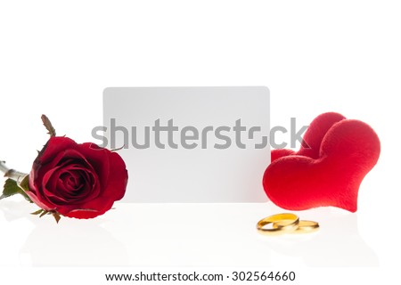 Red rose with  diamond rings  and blank card on white background - stock photo