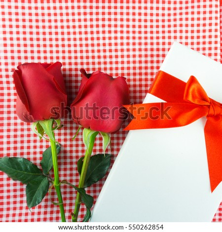 Red rose with message card. Image of Valentines day.