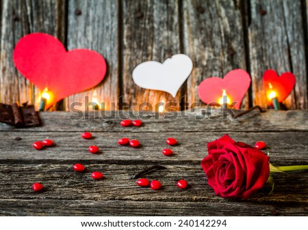 Red Rose with the word Love and hearts on Rustic Old Barn Wood - stock photo