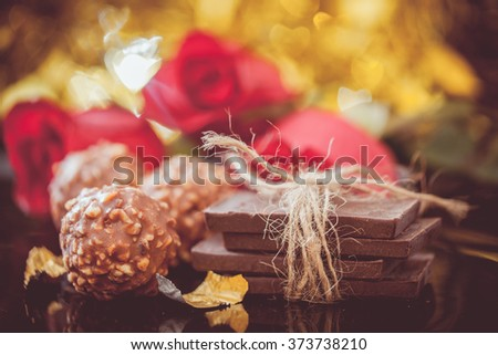 red roses and chocolate  for Valentine's Day