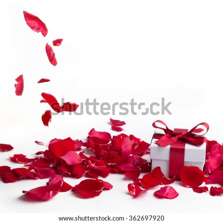 Red roses and gift box on white background,Valentines day concept. - stock photo
