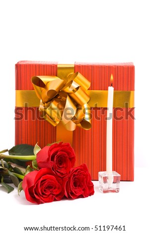 Red roses and gift boxes on a studio white background