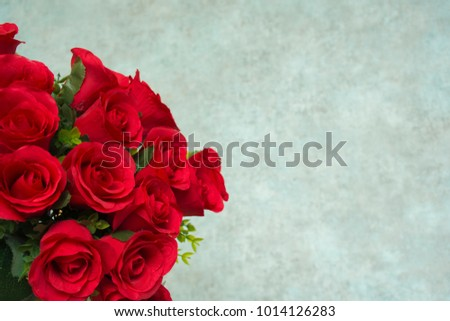 Red roses and retro background space for past a text