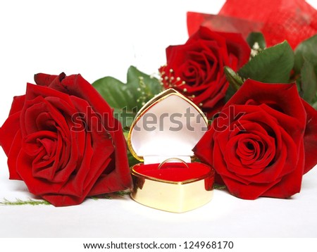 red roses and ring - stock photo