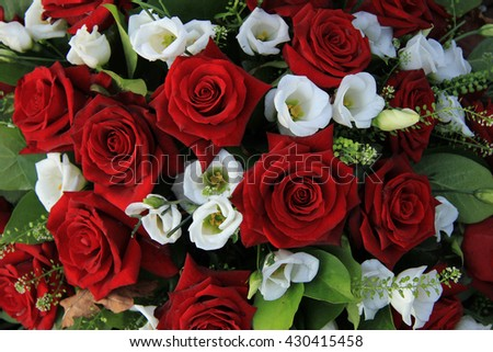 Red roses and white lisianthus in a wedding arrangement