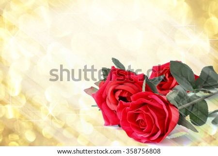 Red roses bouquet with gold light bokeh and free space for text, valentine twinkled bright background.