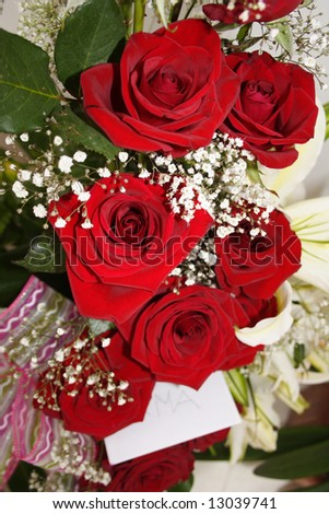 Red roses in a nice bouquet and card - stock photo