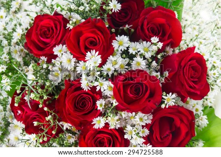 Red roses in bouquet decoration in wedding ceremony.