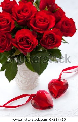 red roses in vase and hearts for Valentine's Day
