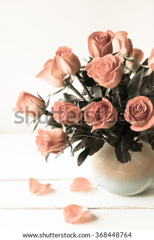 Red roses in vase, vintage filter. - stock photo