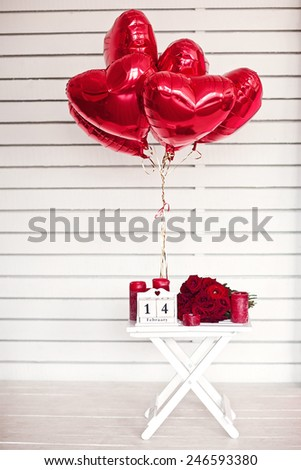 red roses lay on the table near calendar  with the date of February 14 and candle. Valentine's day - stock photo