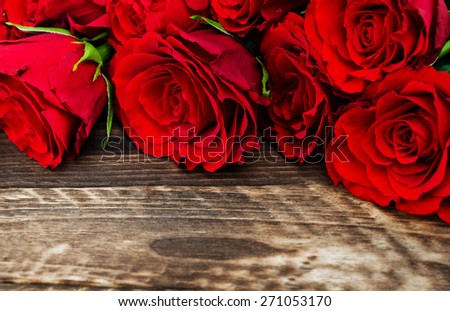 red roses on a wood old panels - stock photo