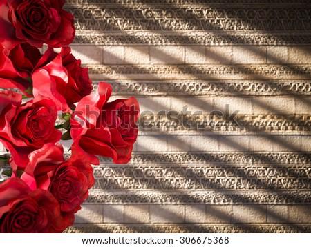 red roses on ancient wall decorative concept background