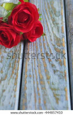 Red roses on old wood board
