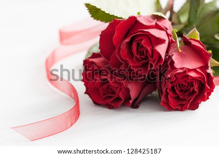 red roses on white wood