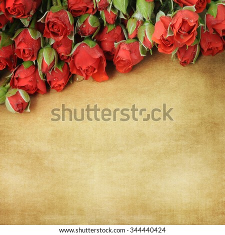 Red roses on wooden table background