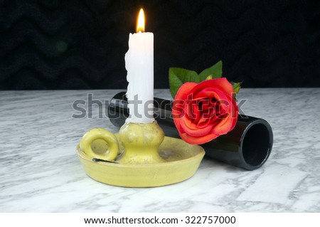 Red roses with black vase, candle on the marble table, still life, art, decoration  - stock photo