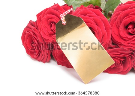 Red roses with blank golden tag isolated on white background. Roses with blank label for your copy  - stock photo
