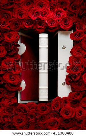 Red roses with white book