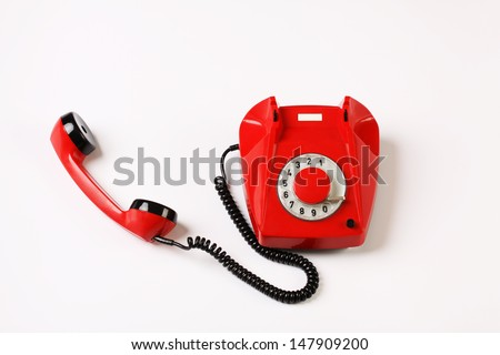 Red rotary telephone off hook on white background, Rotary dial