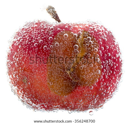 Red rotten apple with water bubbles isolated on white background - stock photo