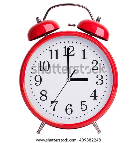 Red round alarm clock shows exactly three hours - stock photo