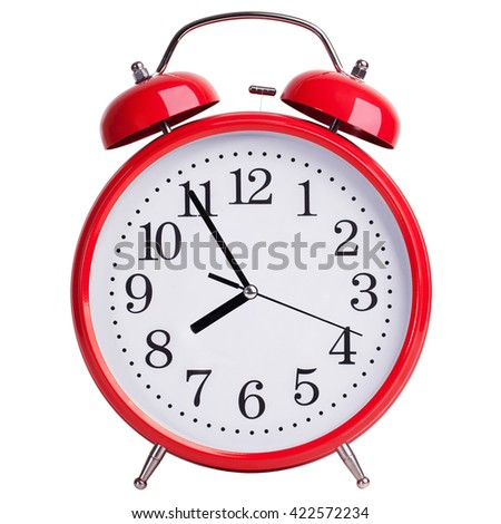 Red round alarm clock shows five minutes to eight - stock photo