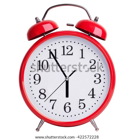 Red round alarm clock shows five minutes to six - stock photo