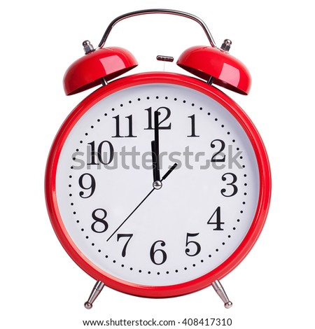 Red round alarm clock shows five minutes to two - stock photo