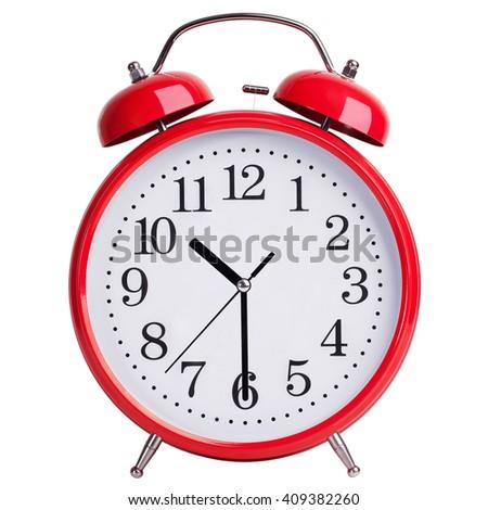 Red round alarm clock shows half past ten - stock photo