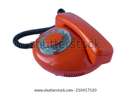 Red round 70s rotary dial phone isolated  - stock photo