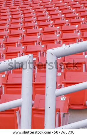 red Rows of empty seat in football stadium