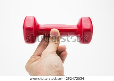 Red rubber coated dumbbell in hand isolated on white background. - stock photo