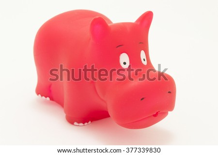 red rubber hippopotamus toy on white background - stock photo