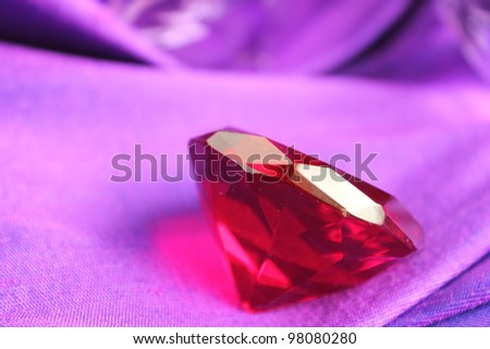 Red ruby on purple cloth