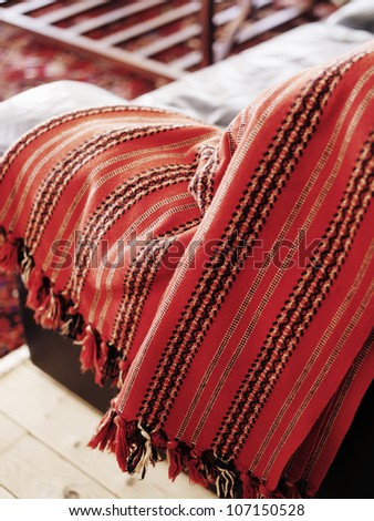 Red rug on an armchair, Sweden. - stock photo