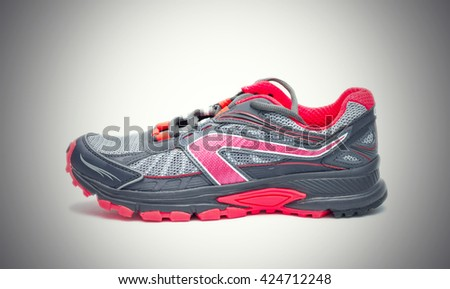 Red running Shoe isolated on gray background. - stock photo