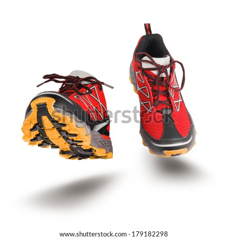 Red running sport shoes seen front, isolated on white background - stock photo