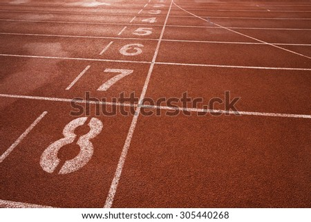 Red running track and lane number  - stock photo