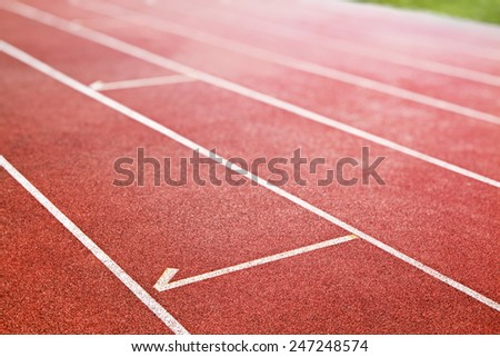 red running track for athletics and competition - stock photo